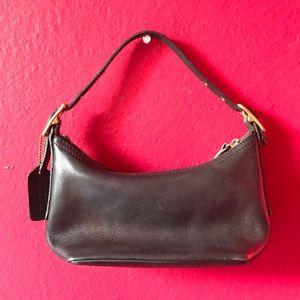 Black leather Hertaige Coach bag